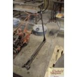 A vintage iron trolley jack