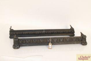 Two Victorian pierced cast iron fenders