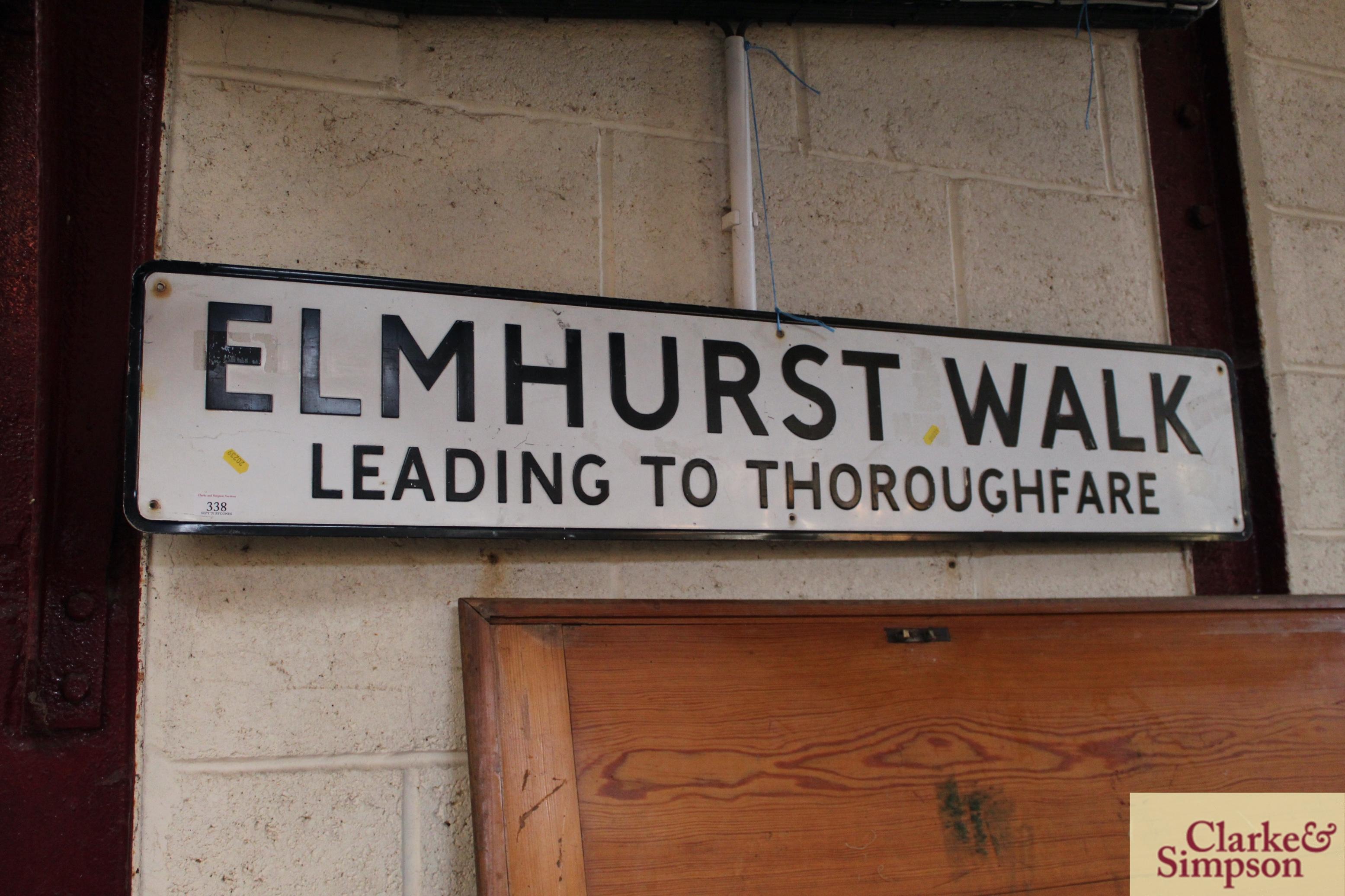 "A metal street sign ""Elmhurst Walk, Leading To Tho"
