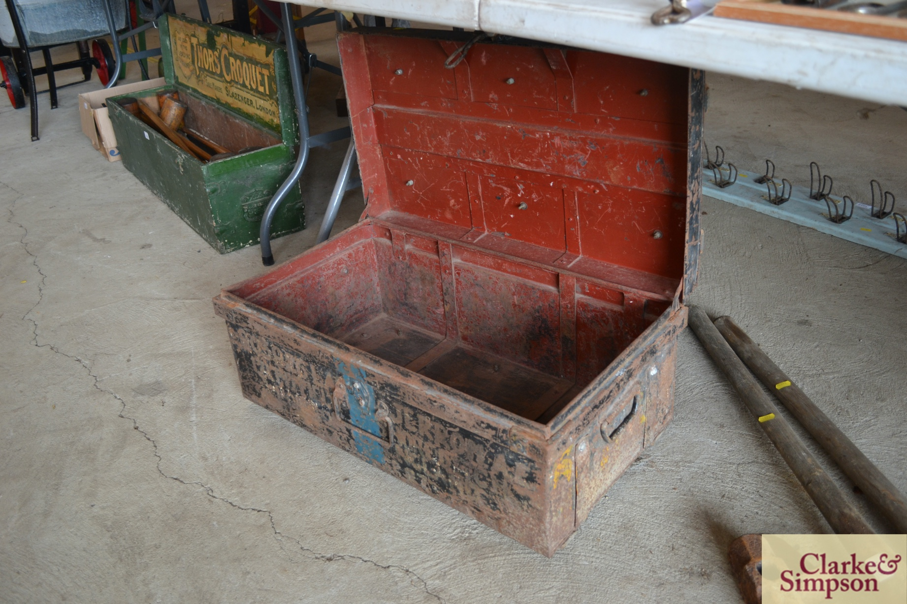 A metalware and wooden bound military tin trunk
