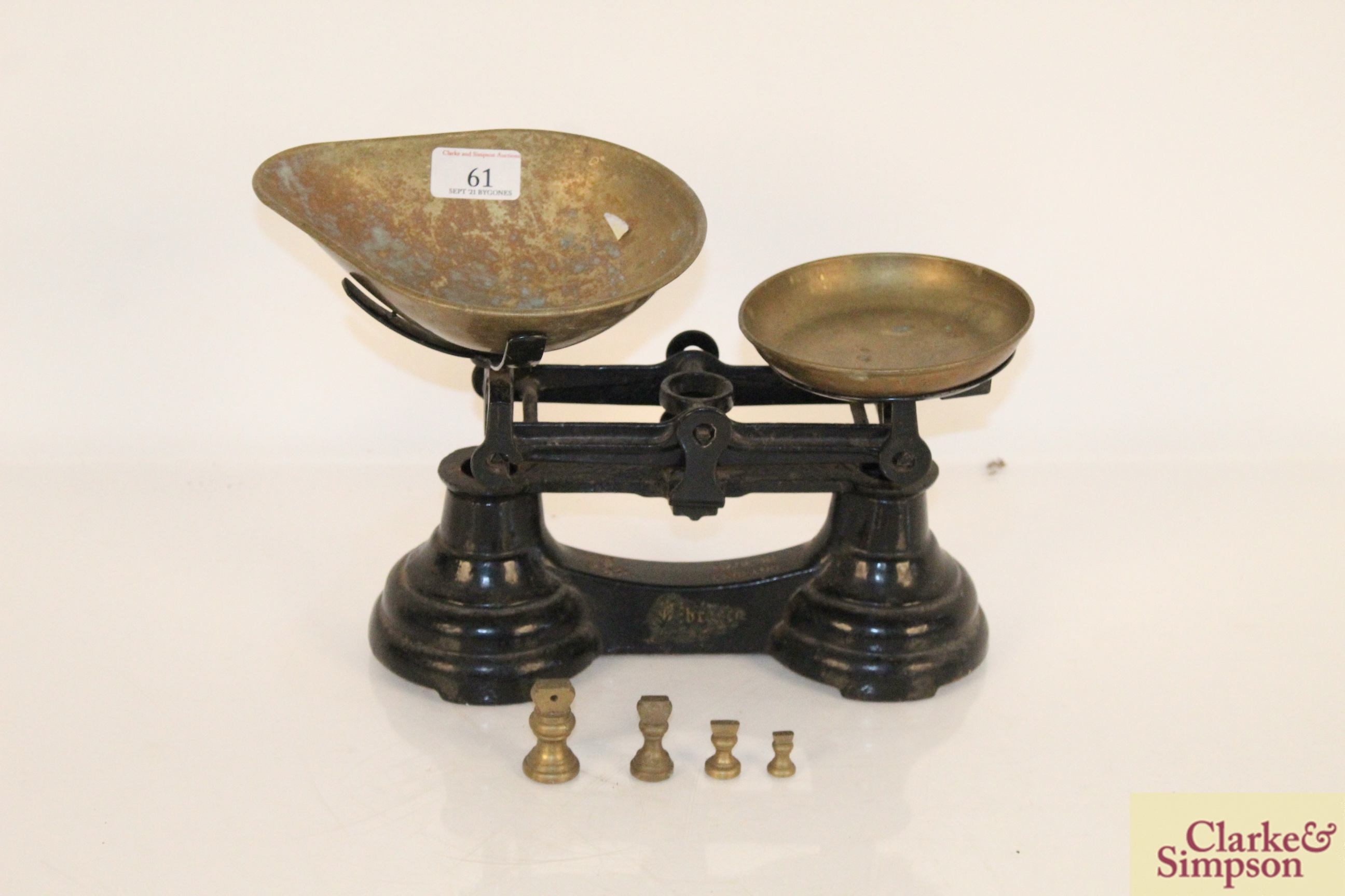 A set of cast iron and brass scales and weights