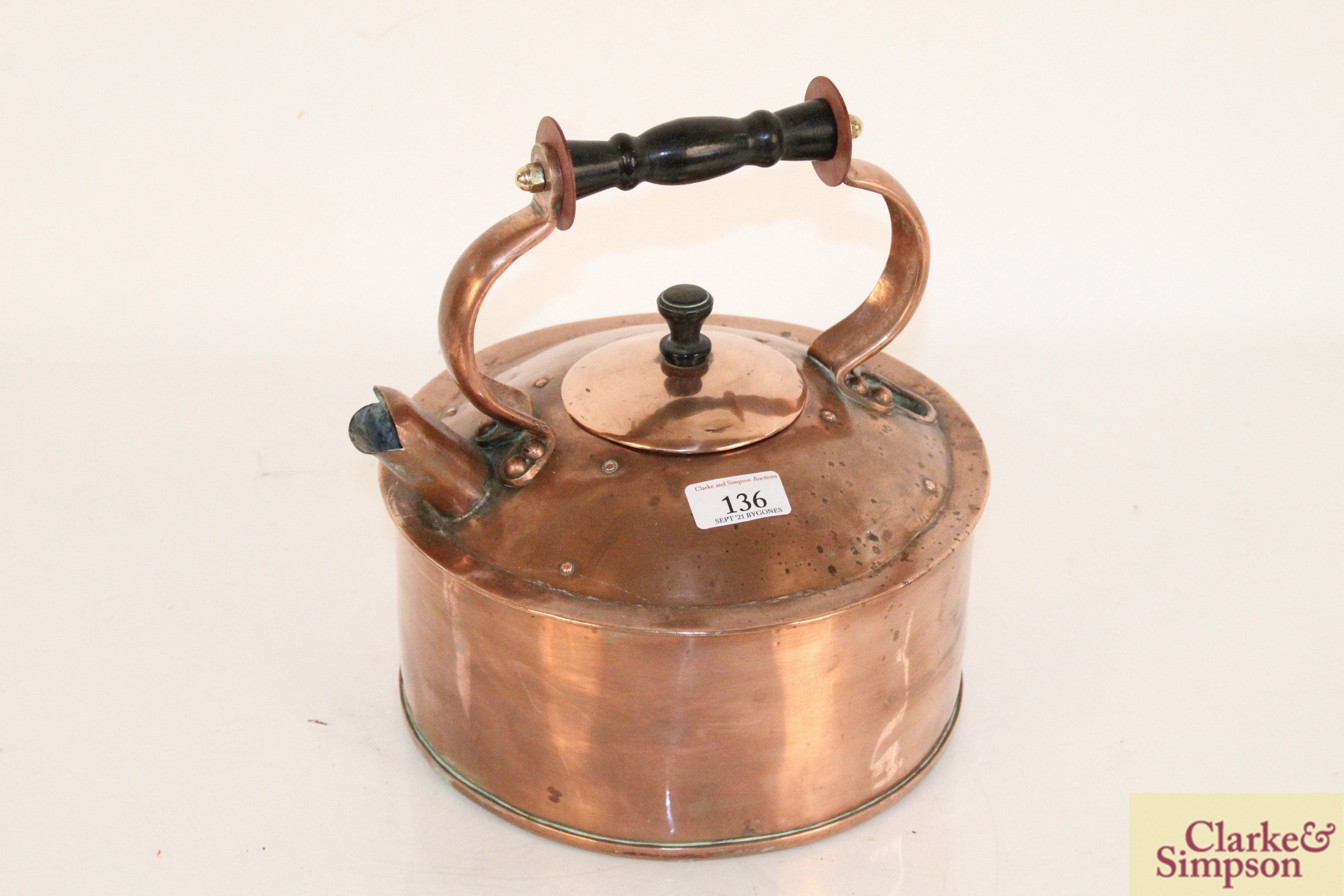 A rare copper fast boil kettle with cast base