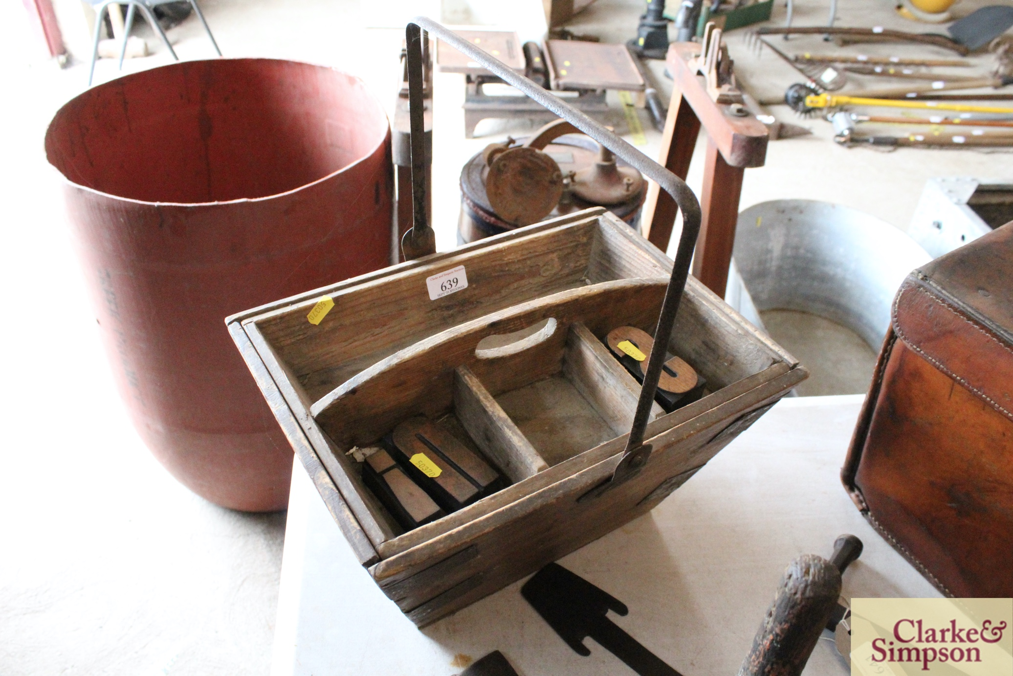 A housemaids wooden box with metal swing handle an