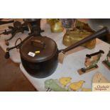 A Baldwin No.10 14 pint cast iron saucepan fitted