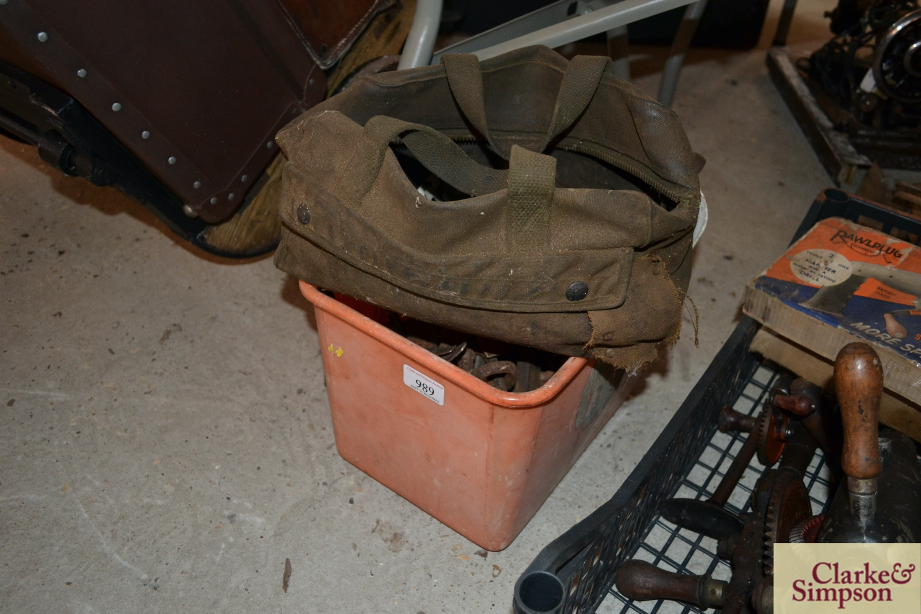A bucket of various tools and a canvas bag of tool