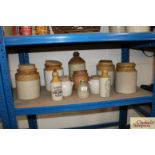 A collection of various stone glazed storage jars