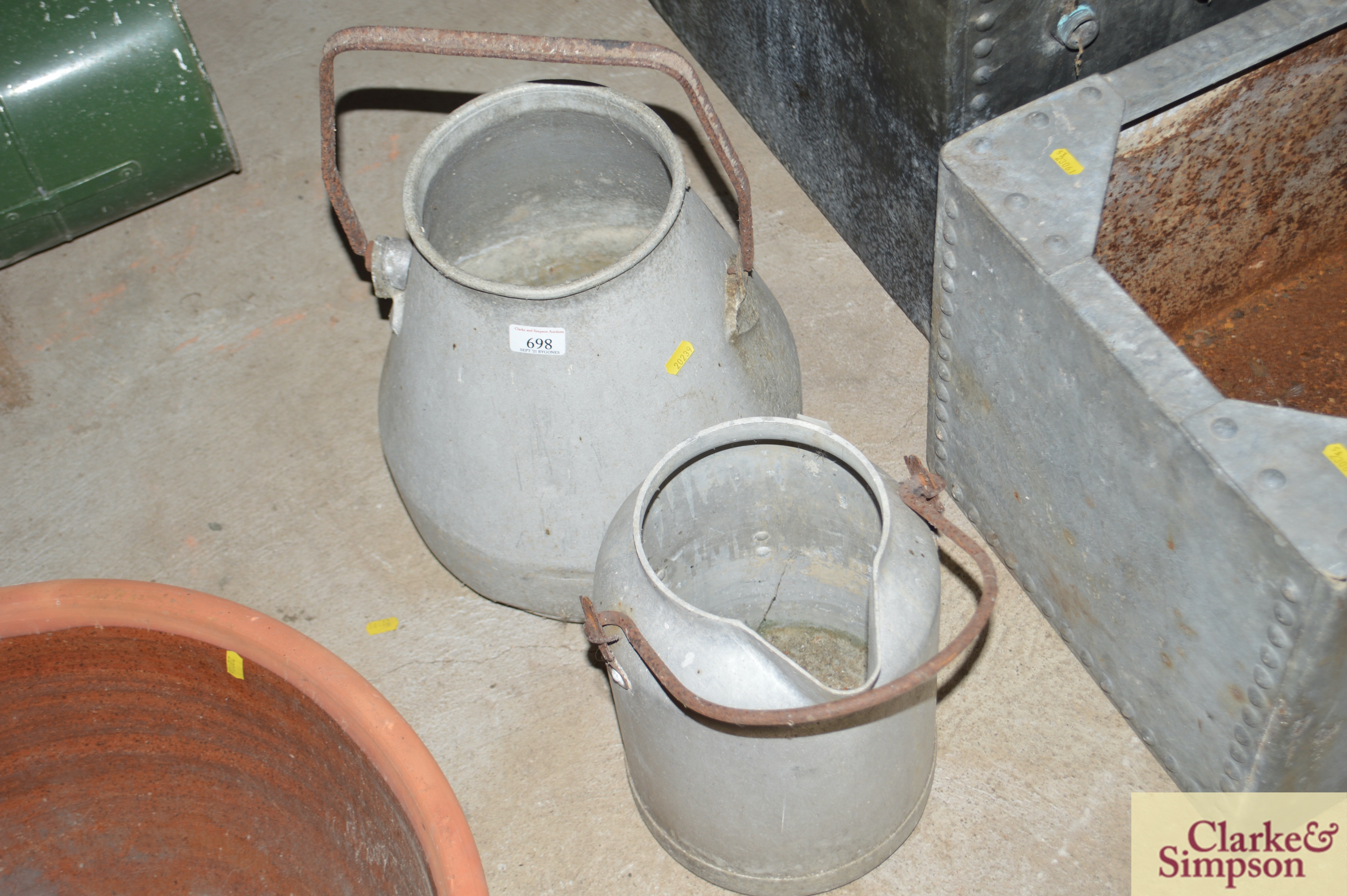 A milk churn with swing handle and another with p