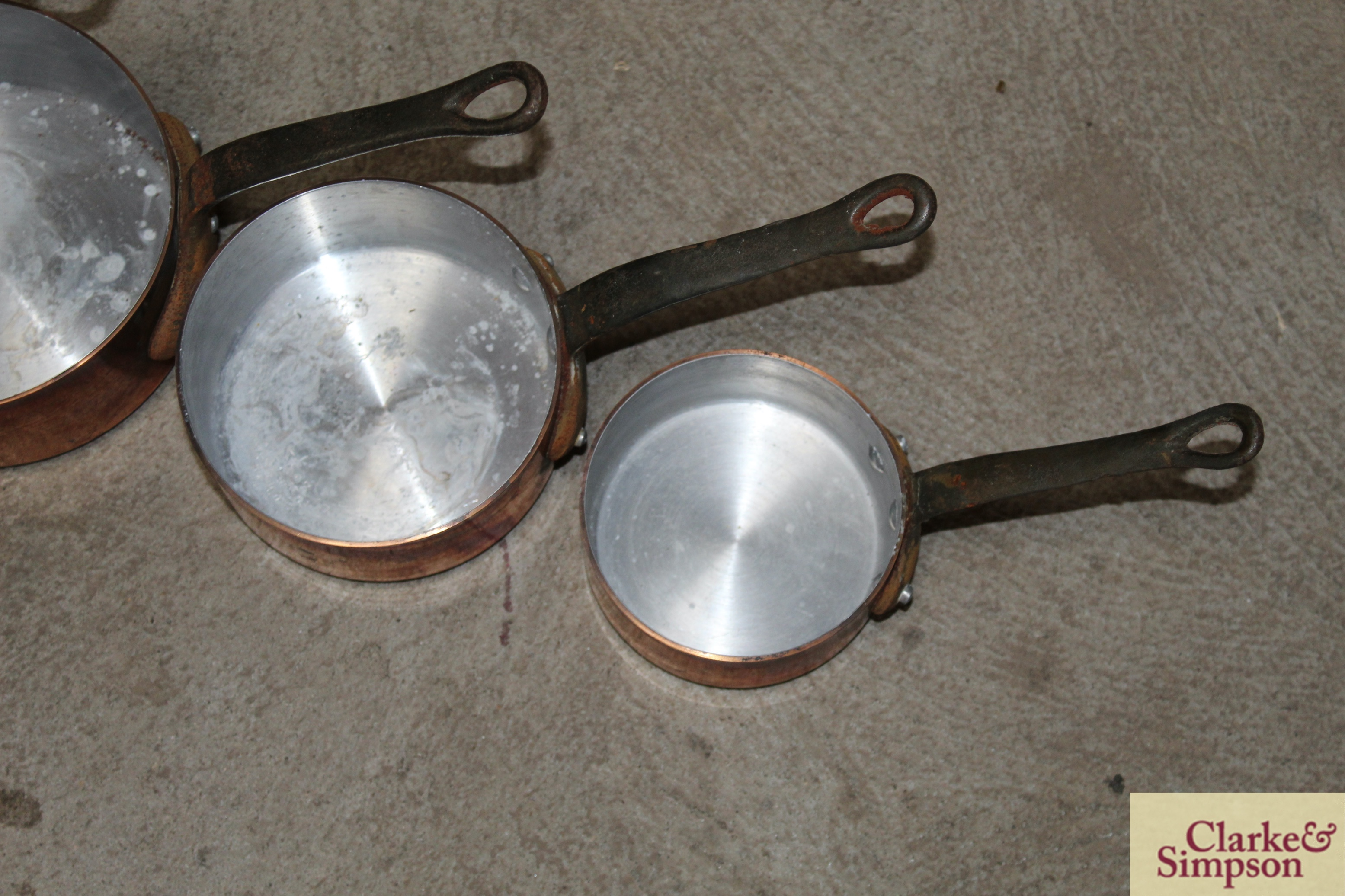 A set of four graduated copper saucepans with iron - Image 4 of 4