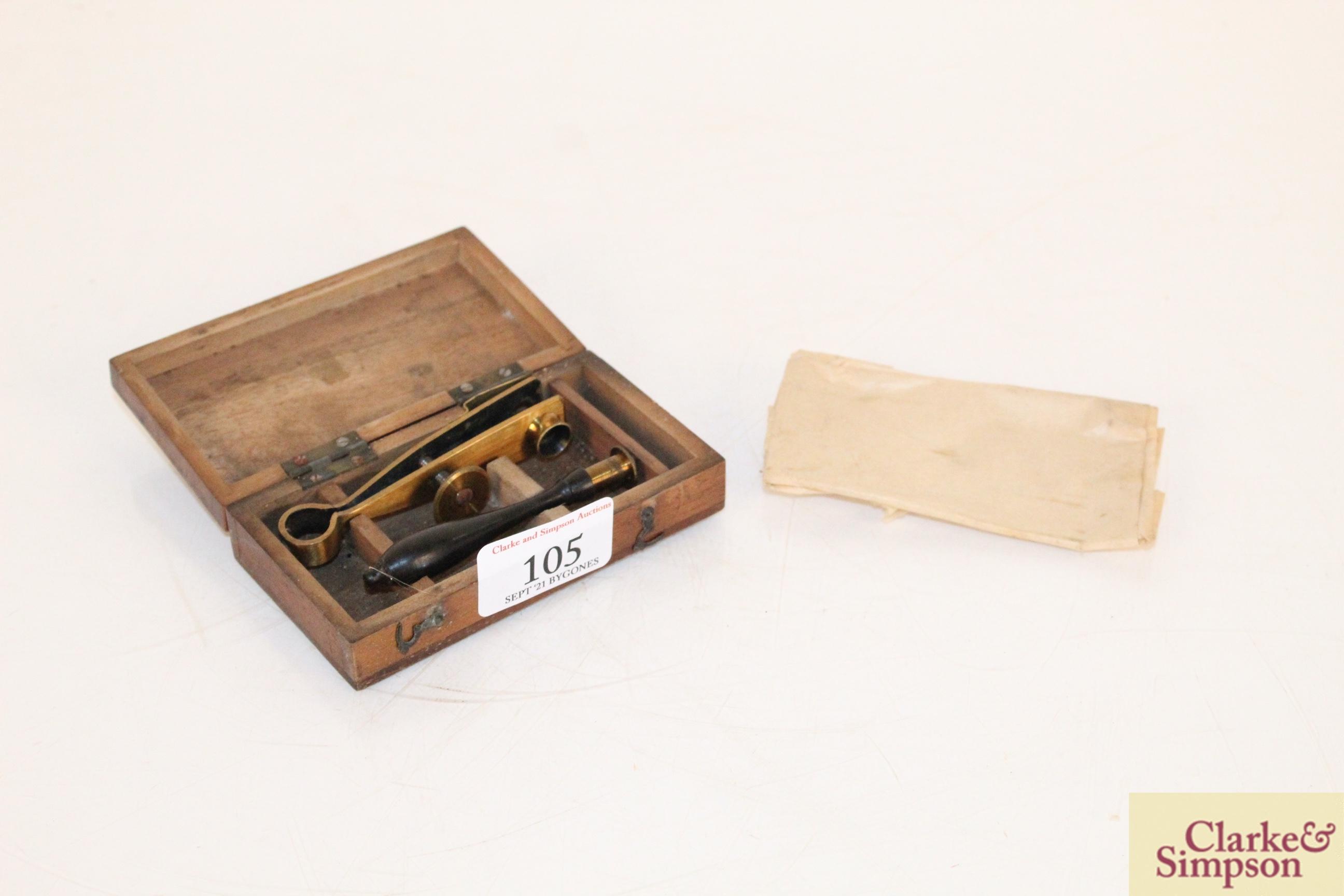 An unusual miniature hand held slide viewer in original box