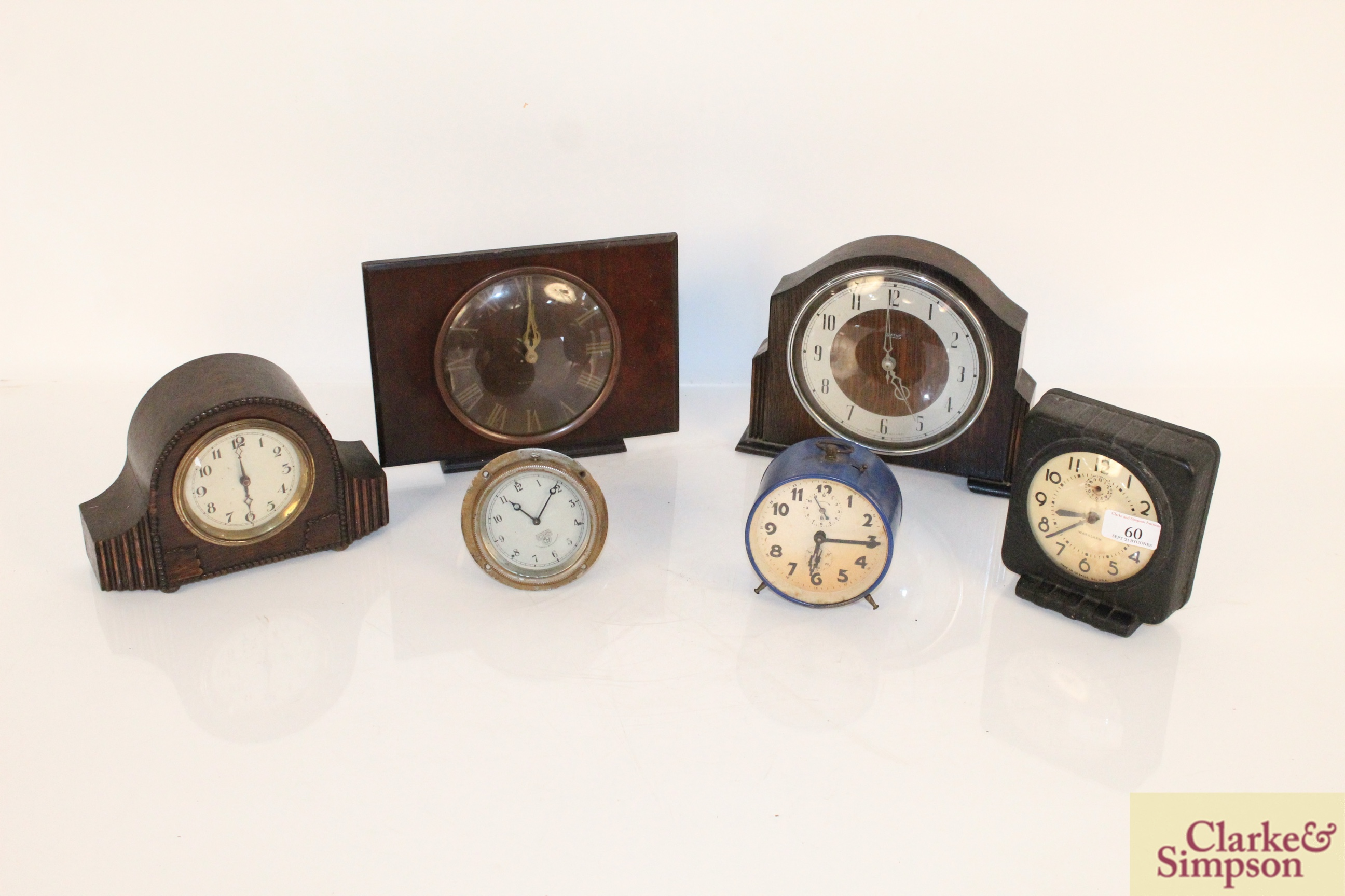 A collection of vintage clocks including a war ala
