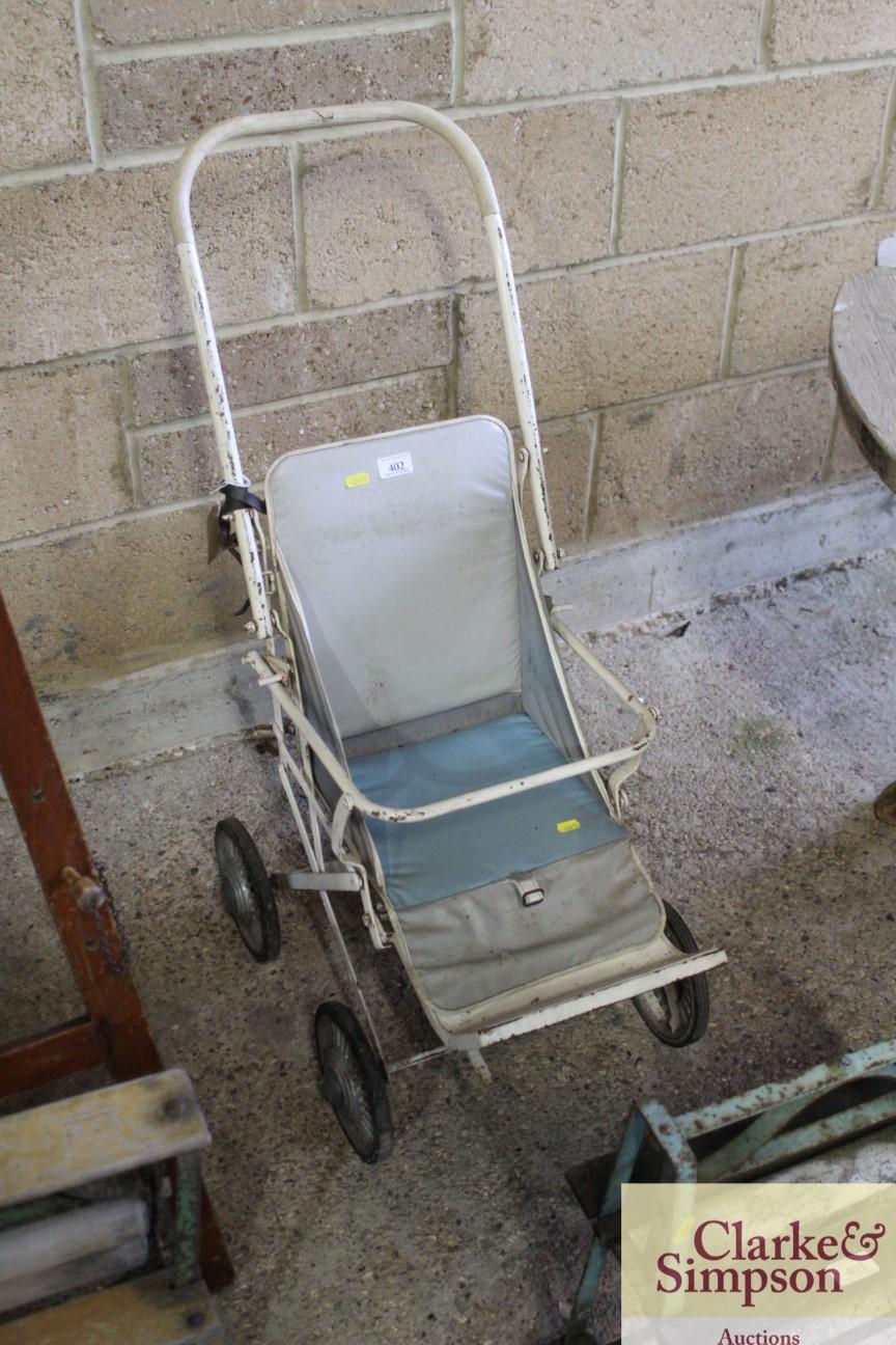 A vintage folding pushchair