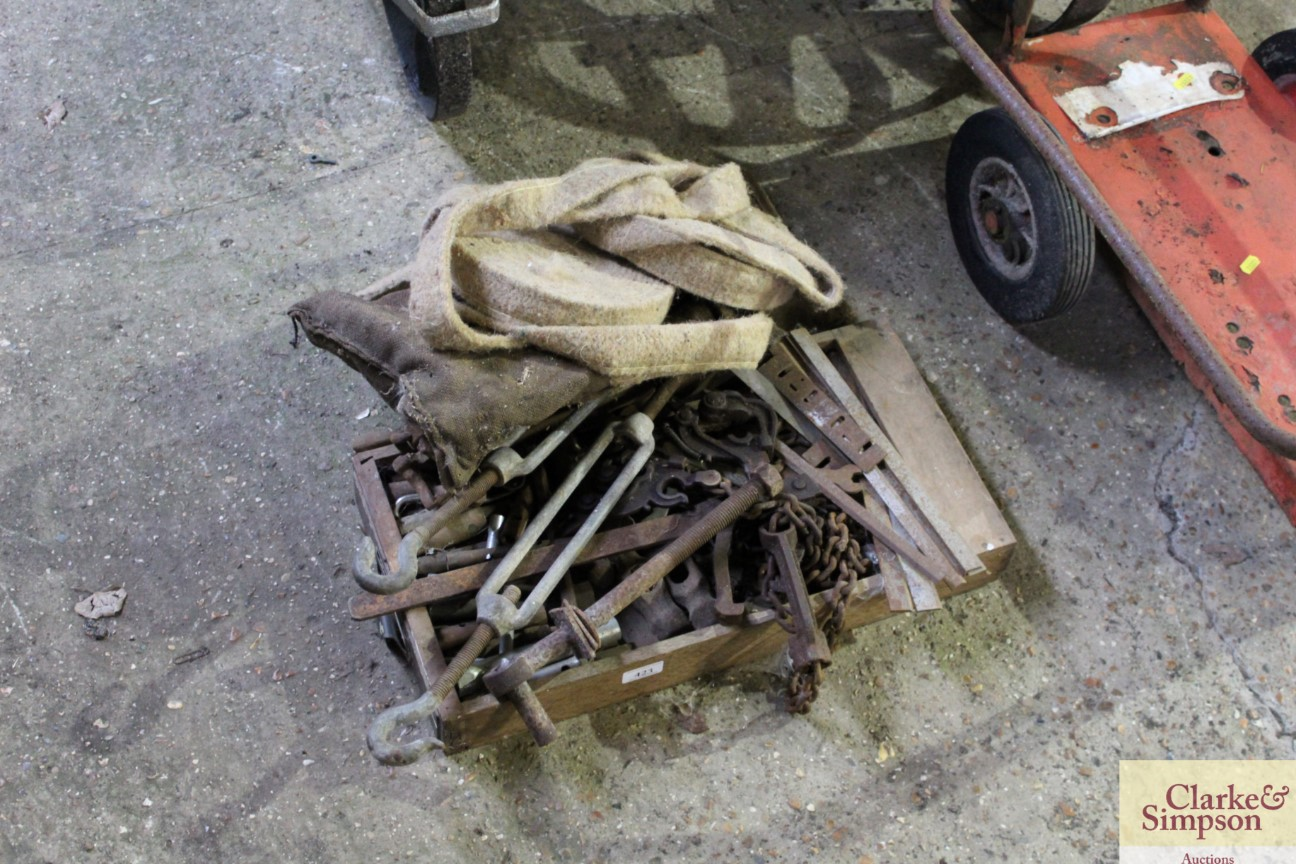 A small roll of pipe lagging and a box containing wire strainers, other metalware etc.