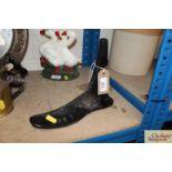 A cast iron shoe last
