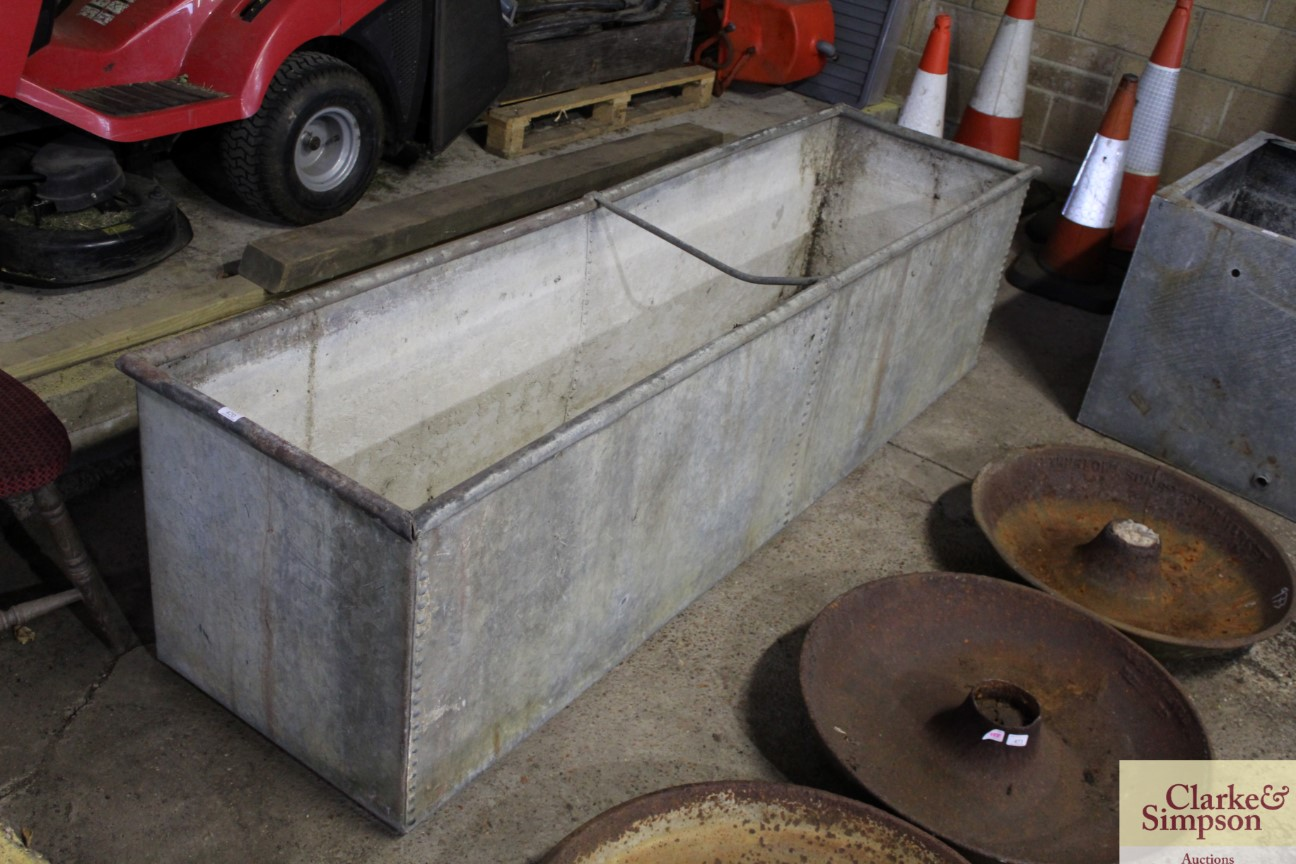 A large galvanised trough approx. 8' long x 3' dee