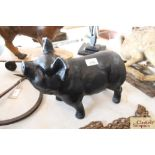 A composition humorous model of a black pig