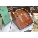 An Edwardian walnut and brass mounted coal box