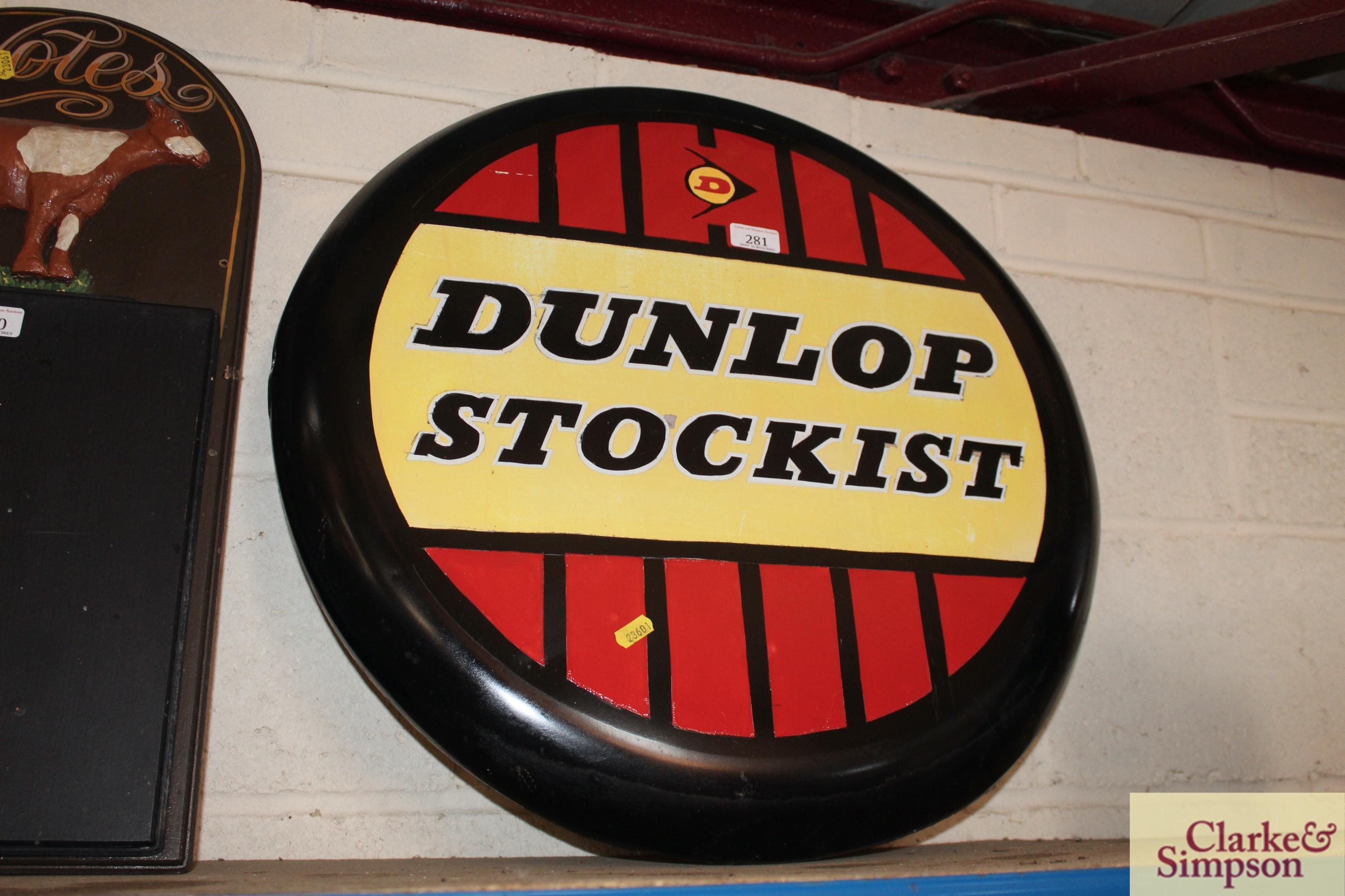 """A circular metal """"Dunlop Stockist"""" advertising sign, approx. 24"""" dia."""