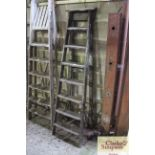 A set of tall vintage wooden steps with carved nam