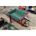 A vintage wooden wheelbarrow with iron wheel