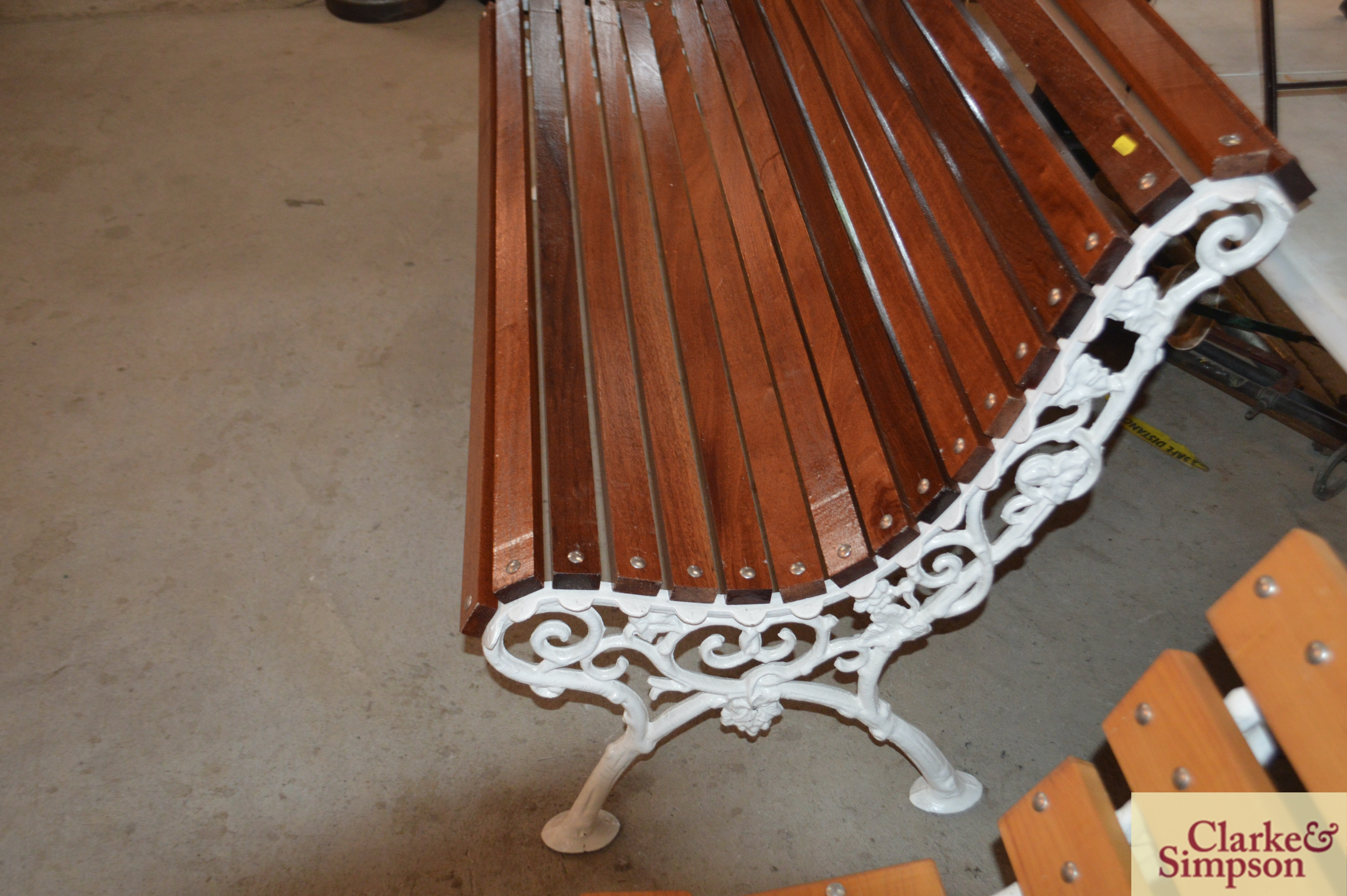 An ornate cast iron and teak slatted roll top benc - Image 4 of 4