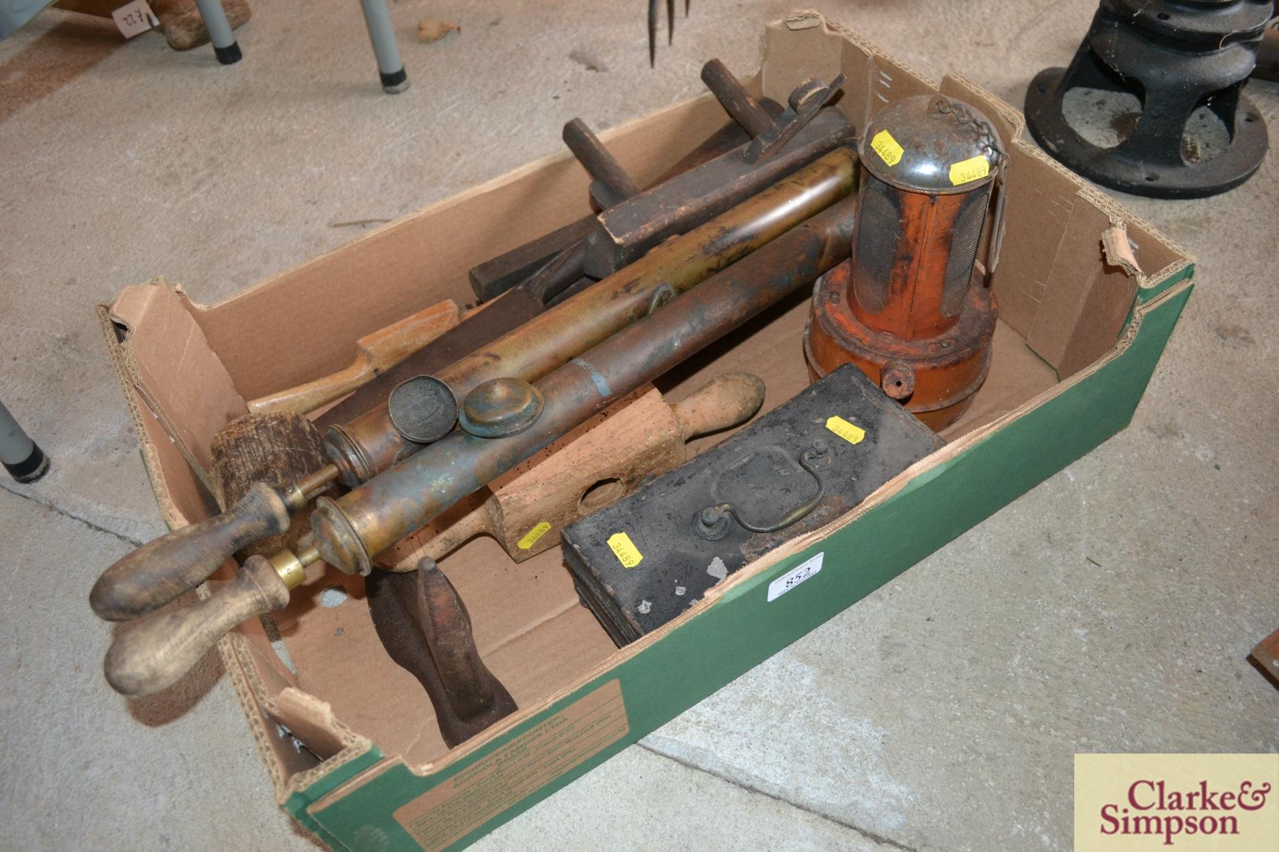 Two vintage brass garden sprayers, a cast iron last,