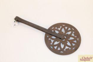 An ornate antique metalware cartwheel measurer