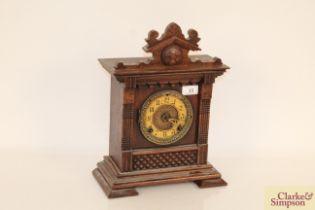 A continental oak cased striking mantel clock