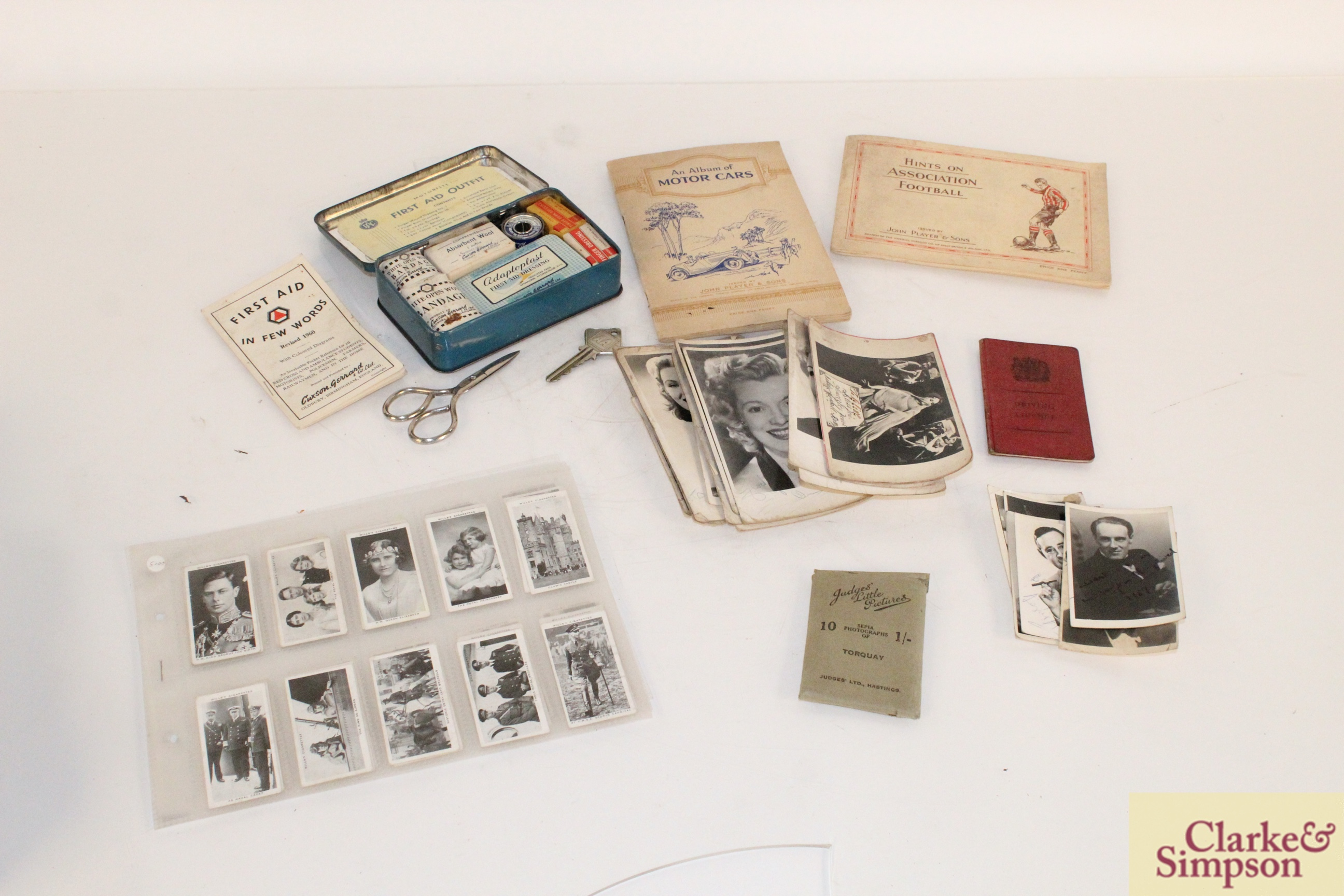 A vintage motorist's First Aid kit; various albums o