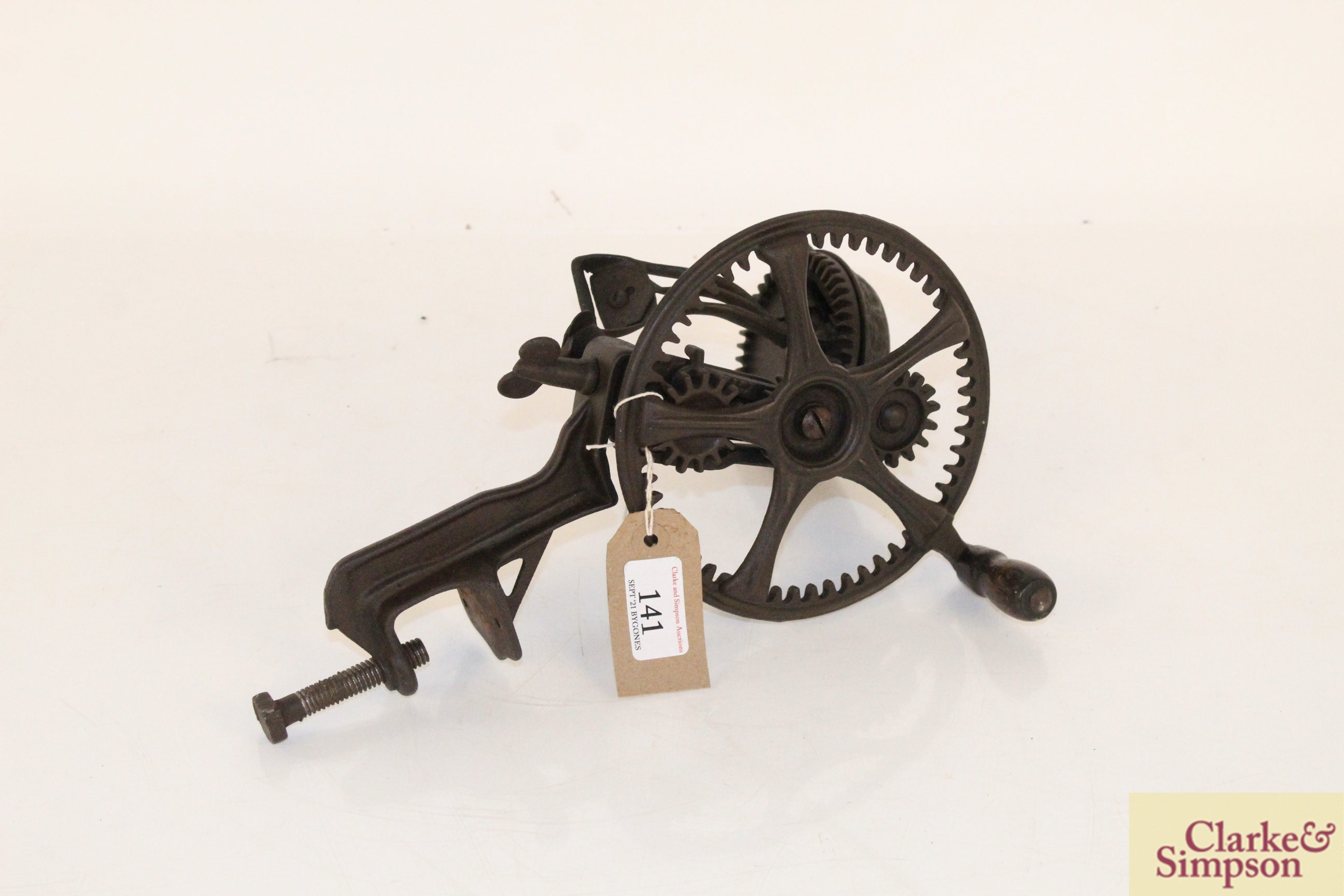 A cast iron apple peeler by The Reading Hardware C