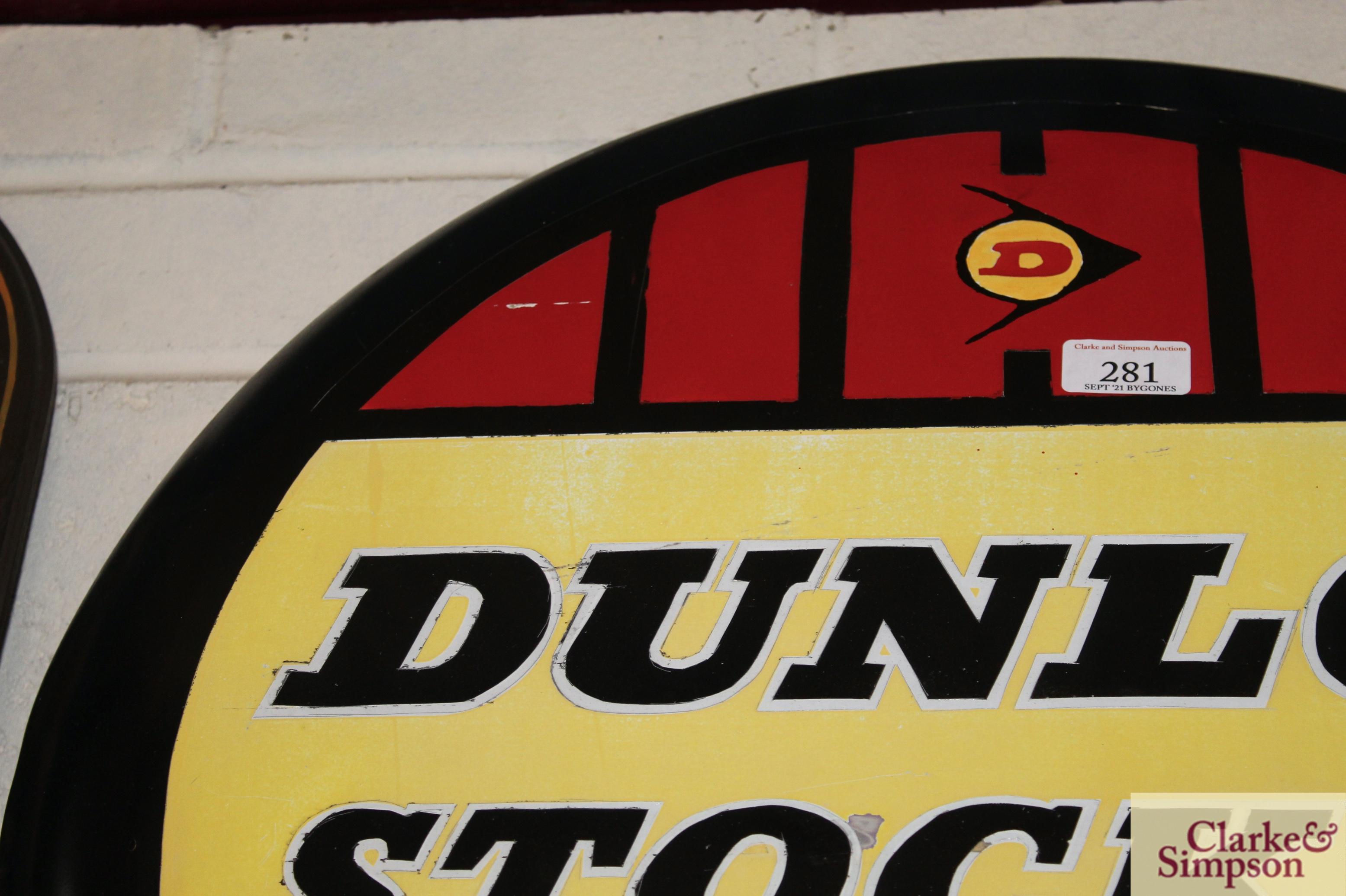 "A circular metal ""Dunlop Stockist"" advertising sign, approx. 24"" dia. - Image 2 of 5"