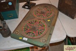 A Lindstom's Gold Star tin plate Bagatelle board