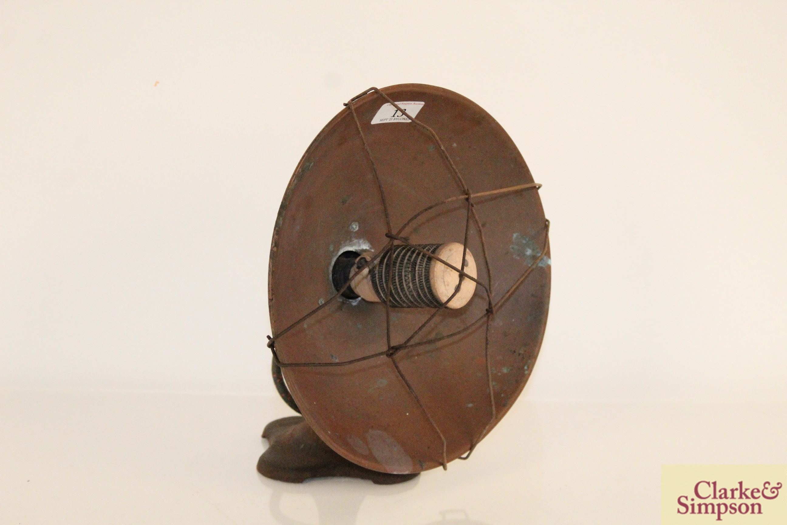 A vintage brass and cast iron electric heater