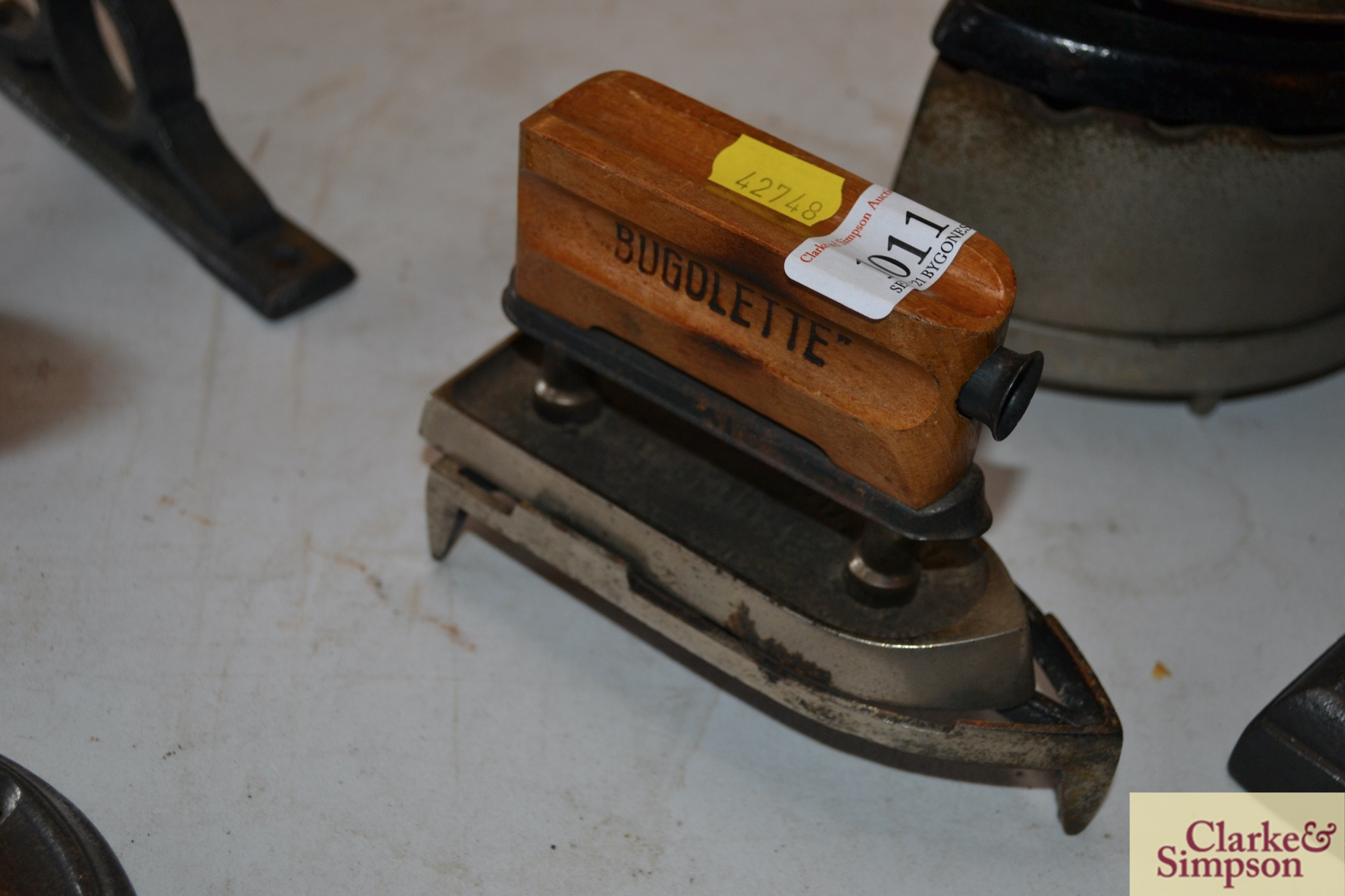 A Bugolette travelling iron with trivet
