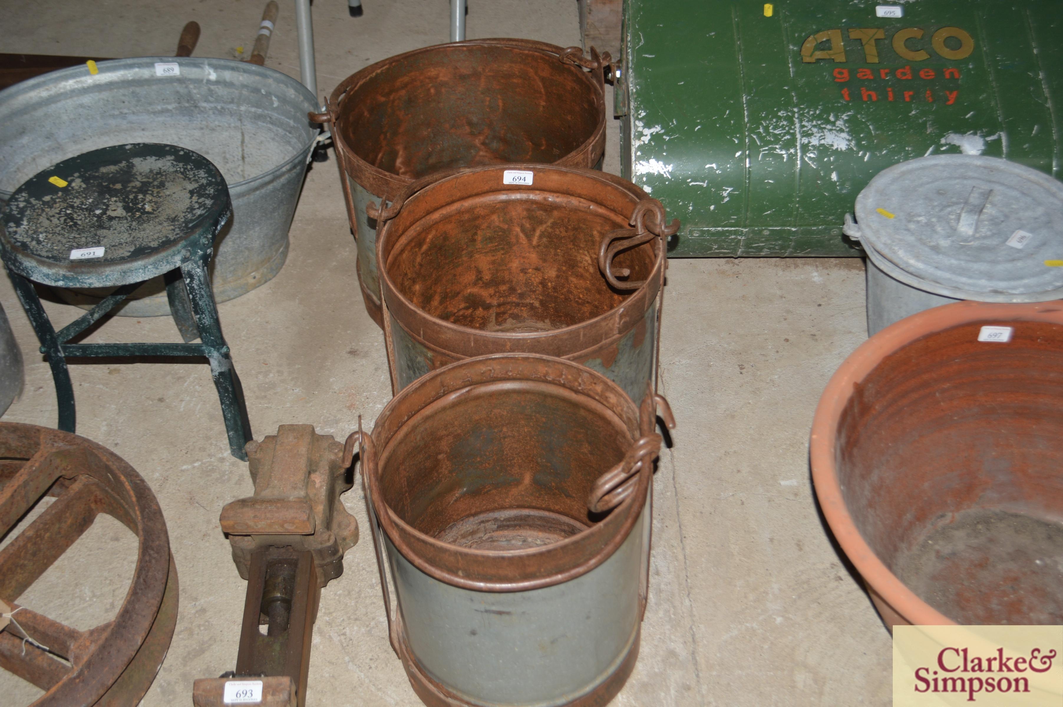 Three graduated galvanised and iron pails with swi