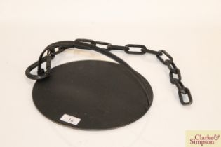 A cast iron swing handled skillet with chain