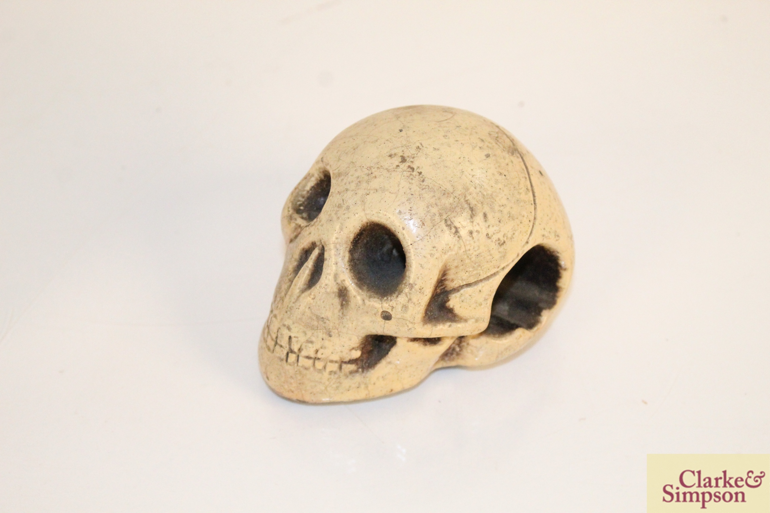 A lead casket containing a faux ivory skull - Image 6 of 7