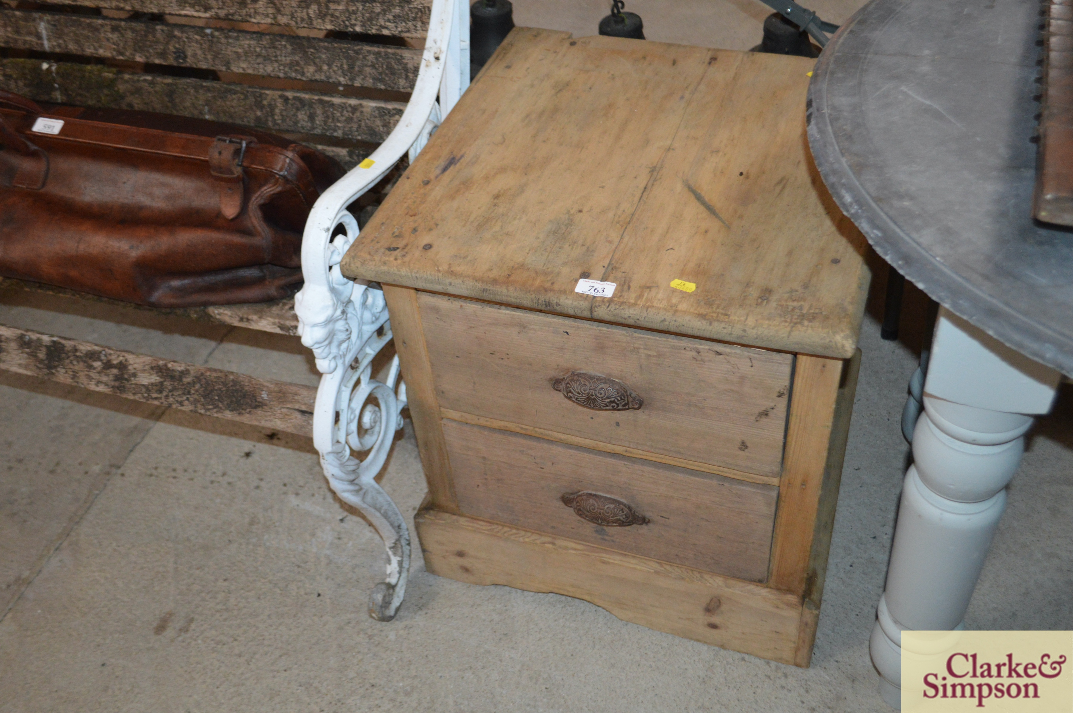An antique stripped pine ironmongers two drawer ca