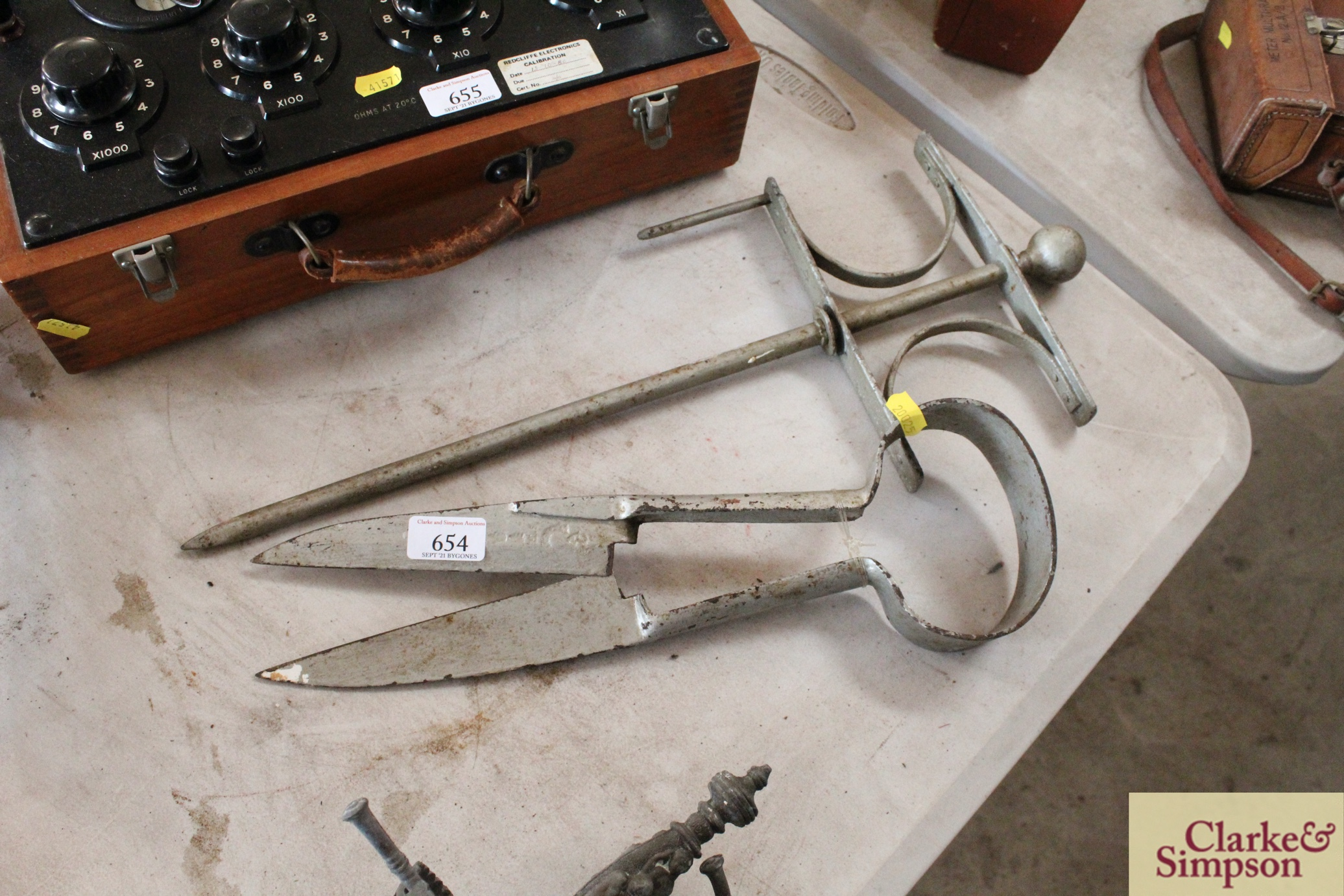A pair of vintage thatcher's shears and a garden