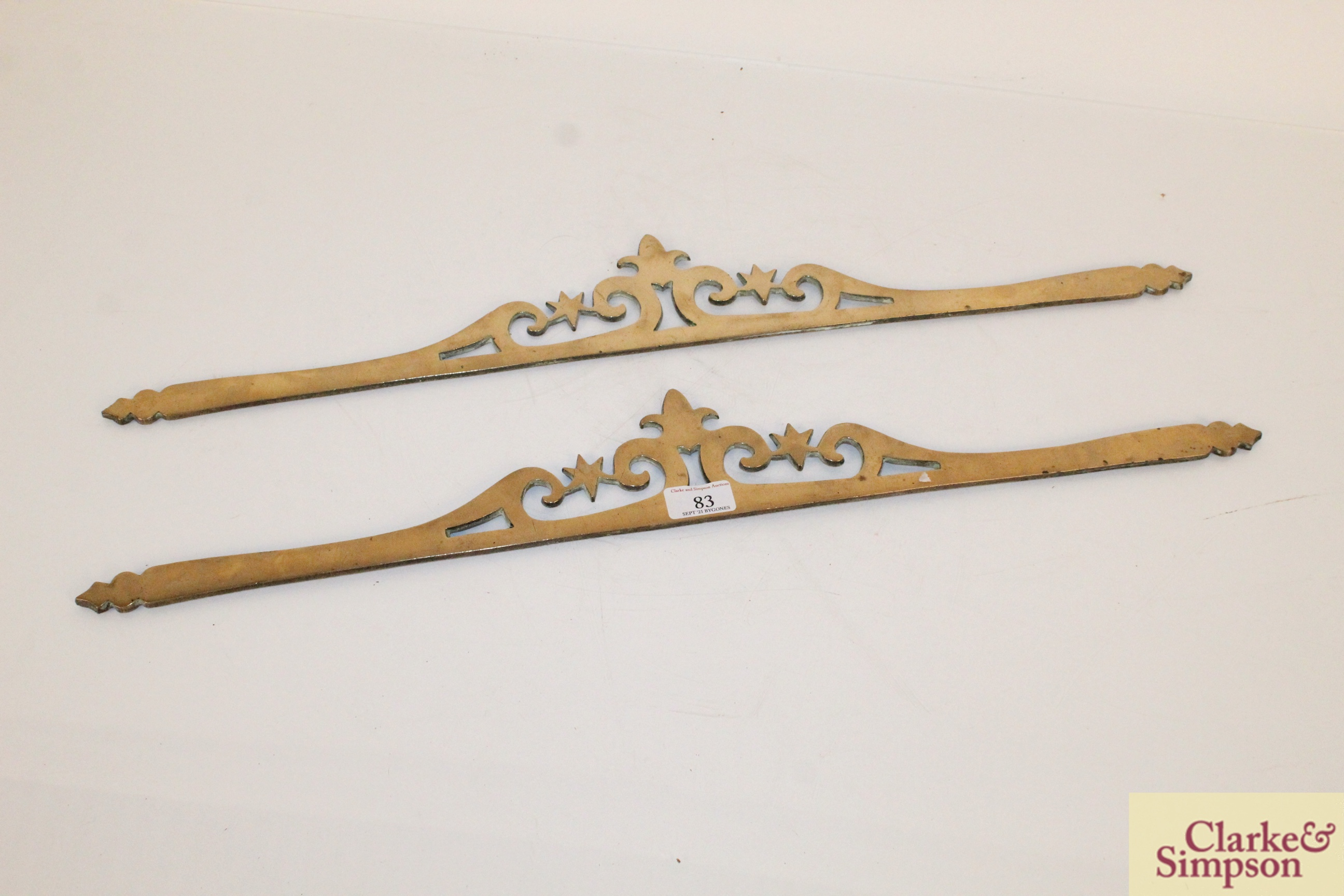 A pair of ornate brass decorative strips