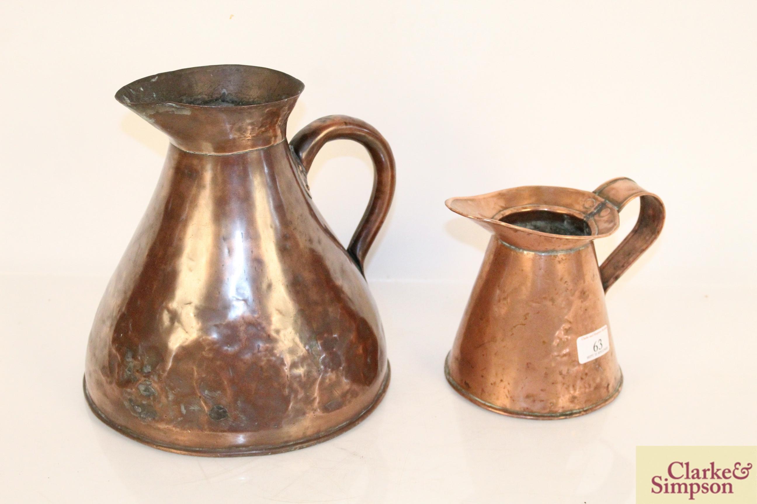 Two antique copper jugs