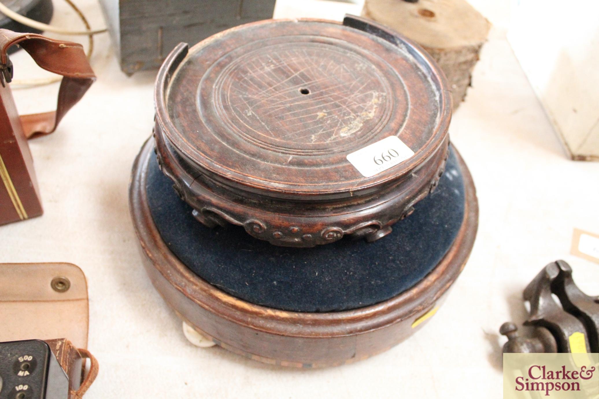 A Victorian circular walnut foot stool raised on c