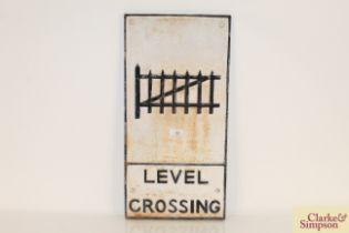 "A cast metal road sign ""Level Crossing"", 24"" x 11½"