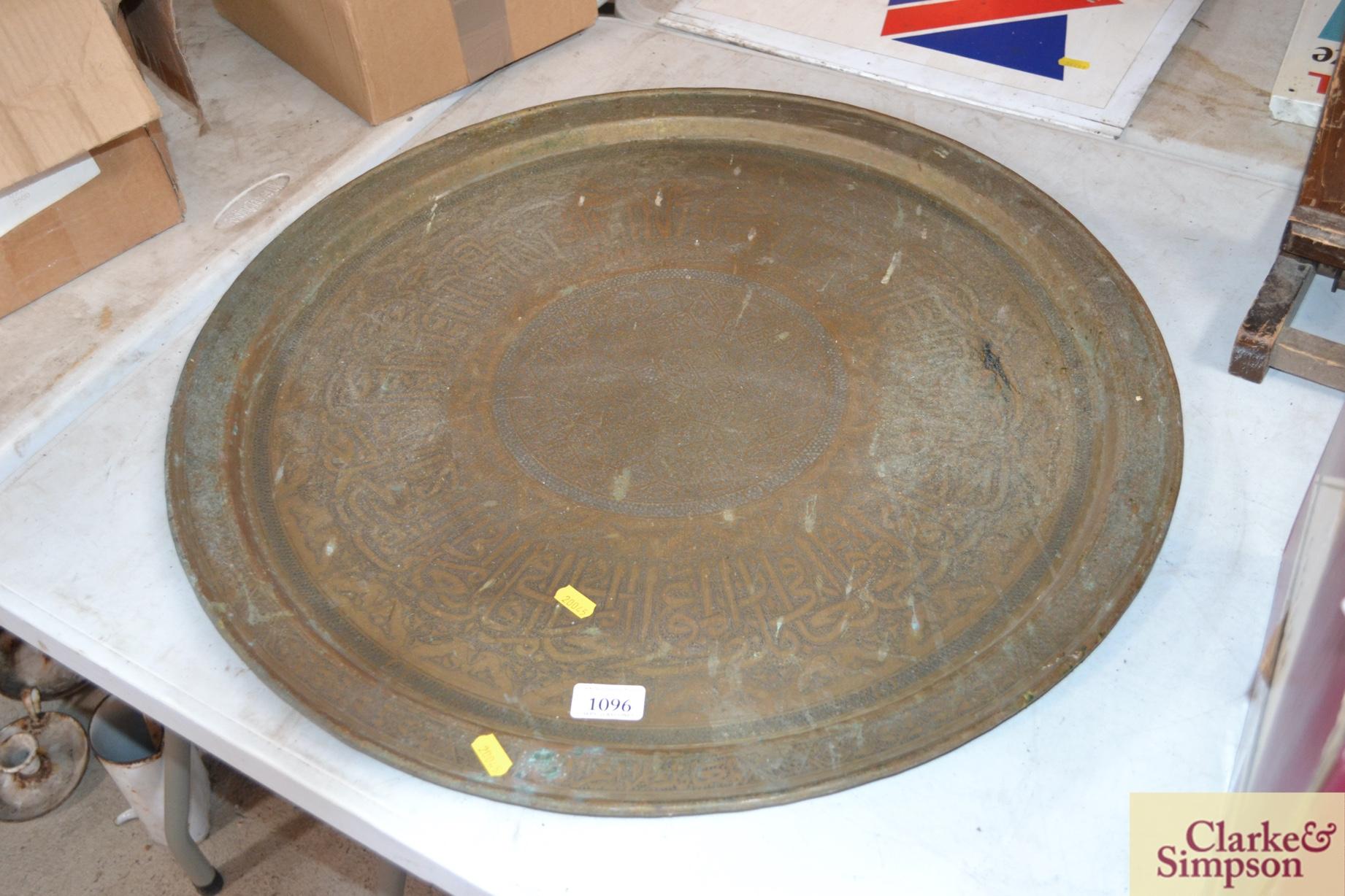 An Eastern circular brass tray