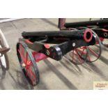 An ornamental replica field cannon with iron wheel