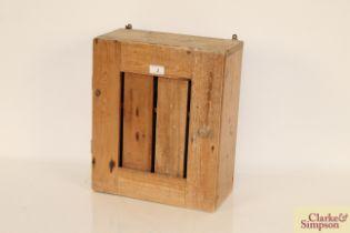 A rustic pine wall cupboard