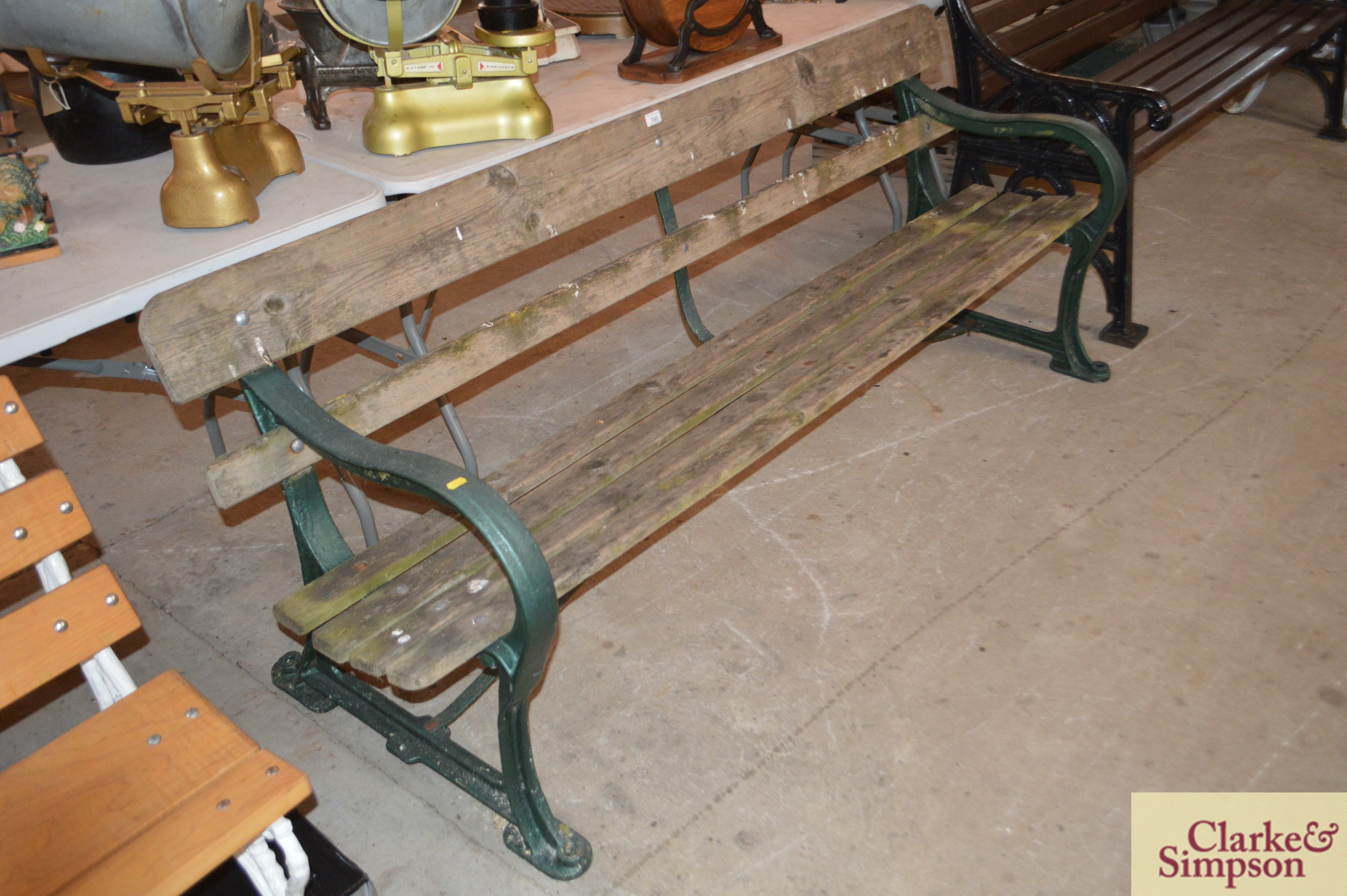 A cast iron and wooden slatted railway type bench