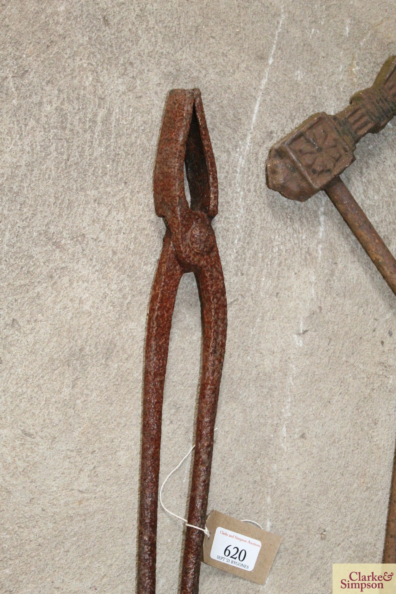 A pair of iron foundry tongs and a decorative iro - Image 2 of 6
