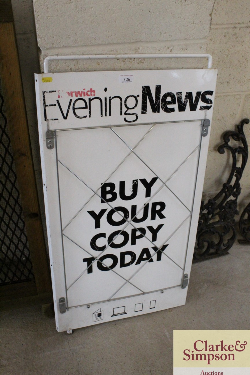 An enamel newspaper advertising stand for The Norw
