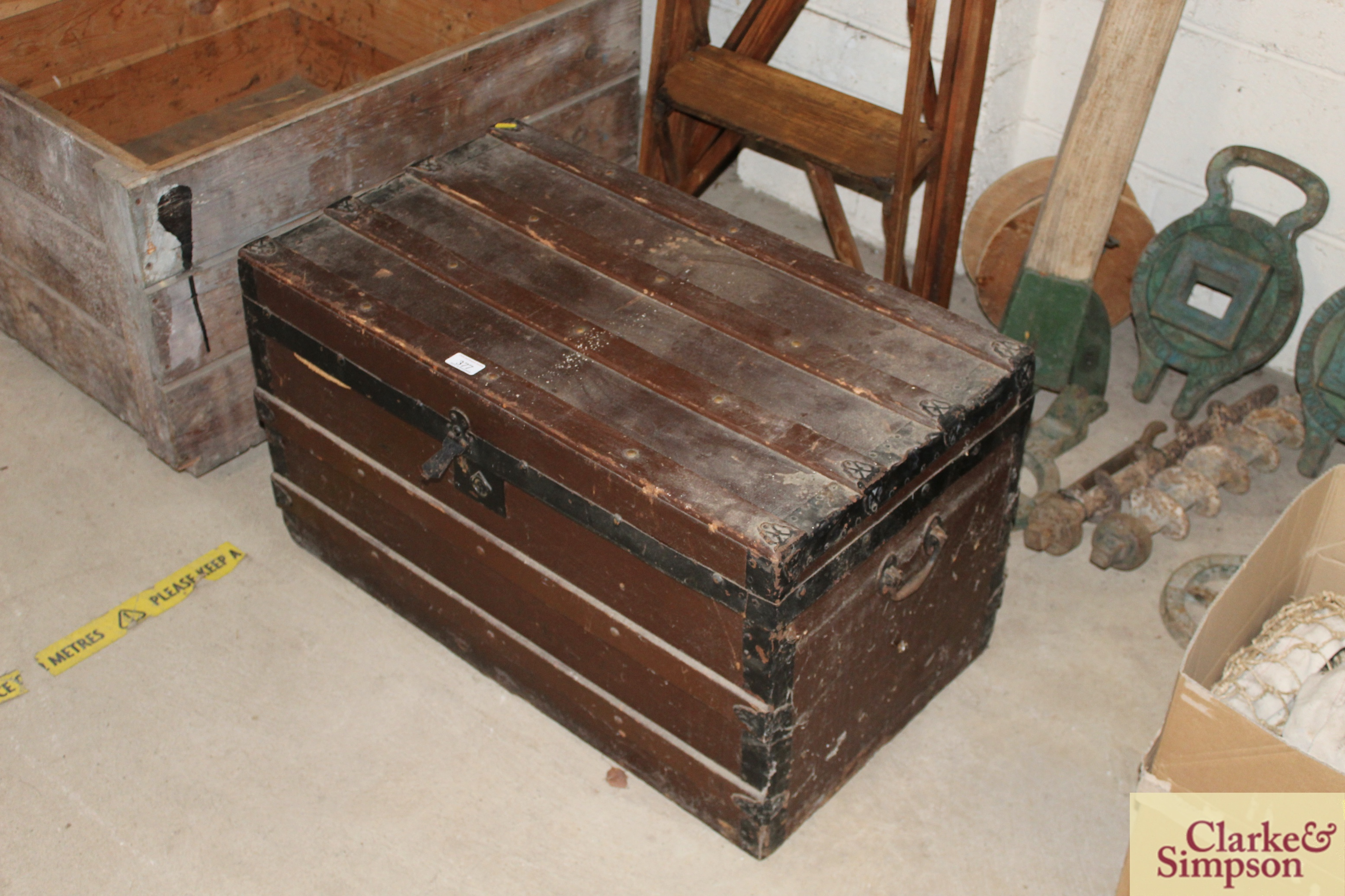 A vintage wooden trunk with metal mounts and carry - Image 2 of 4