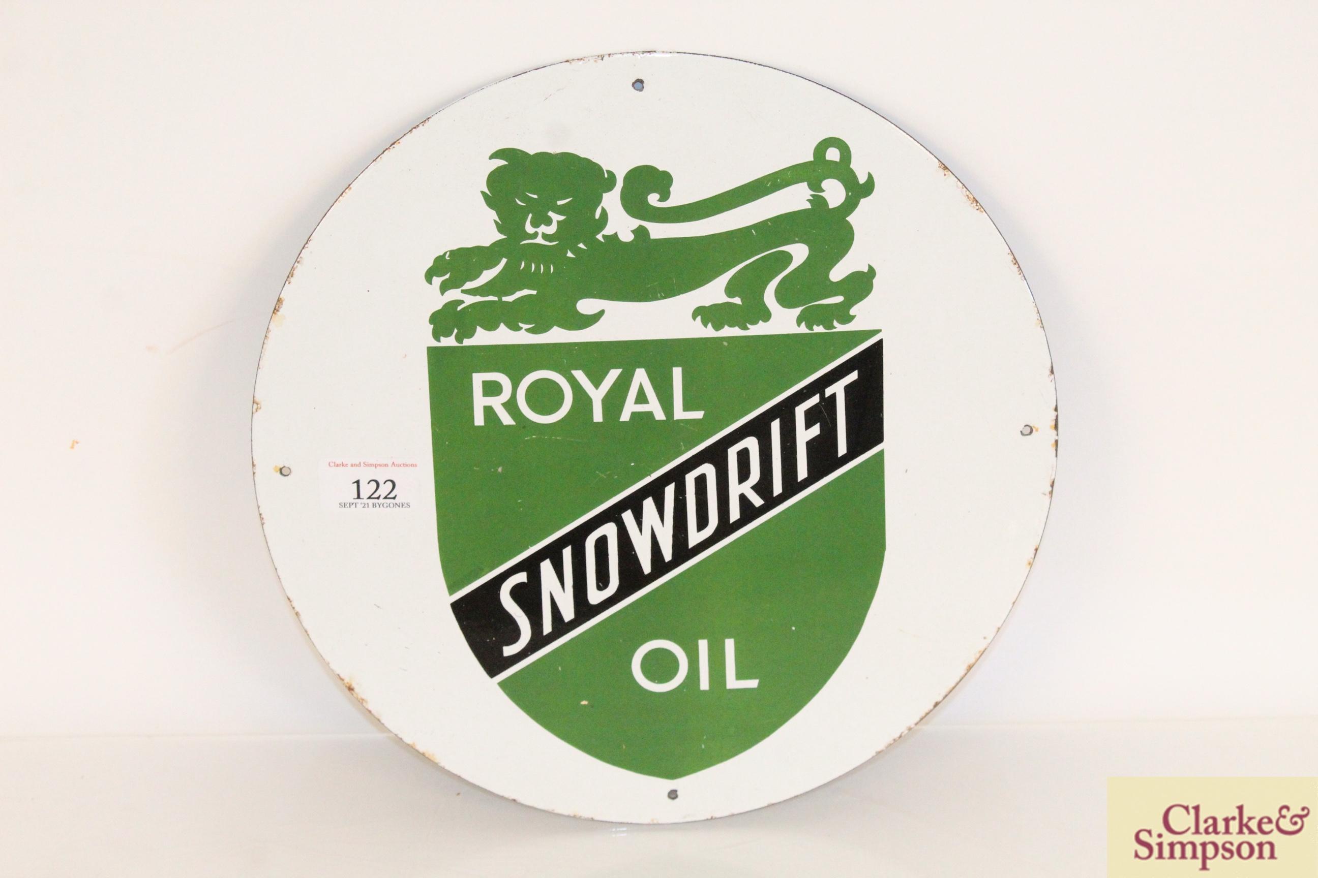 "A circular enamel sign for ""Royal Snowdrift Oil"","